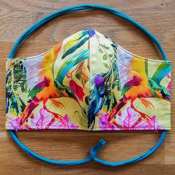 Fabric facemask with tropical plants, flowers and birds