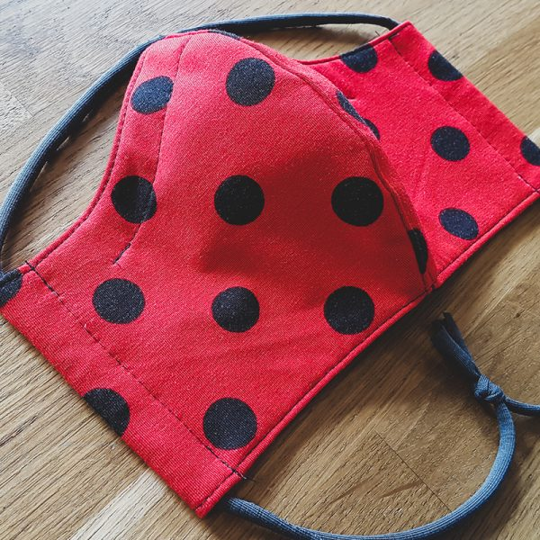 Fabric facemask with retro polkadots print (black dots on red)