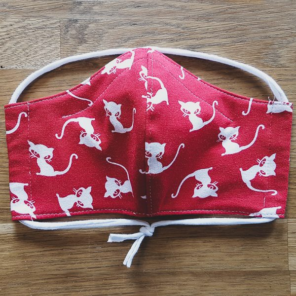 Fabric facemask with white cats on bright red print
