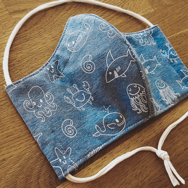 Fabric facemask with white sea animals on a light blue background (jellyfish, octopus, fish, crabs and more!)
