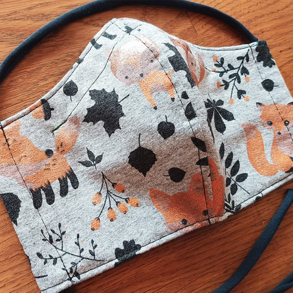 Fabric facemask autumn themed with cute bronze foxes and autumn leaves print