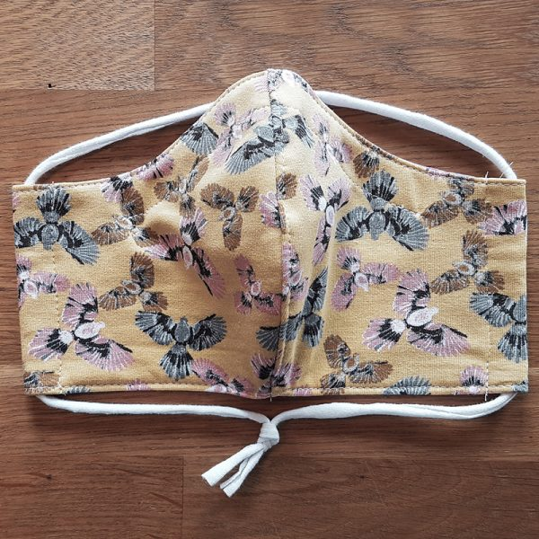 Fabric facemask with cute flying birds print