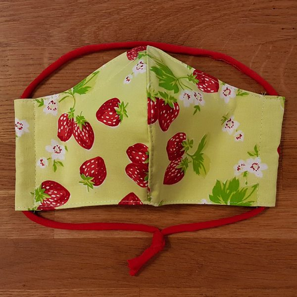 Fabric facemask with cute strawberries on a light green background