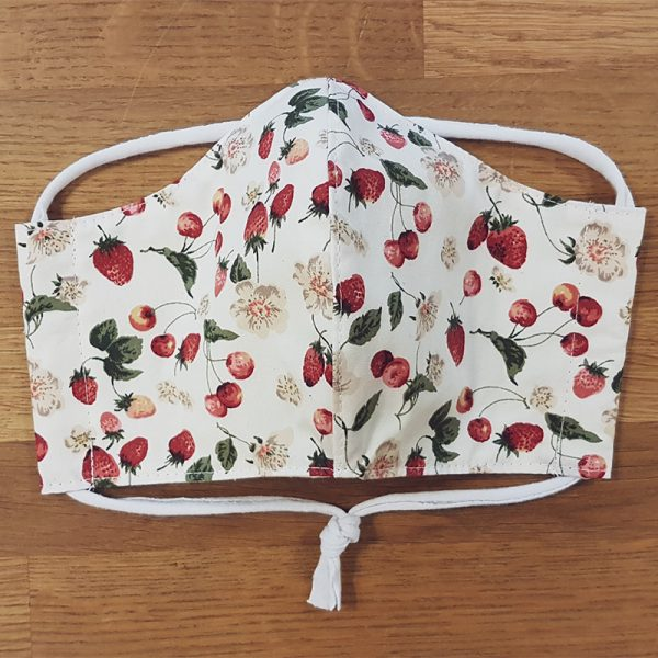 Fabric facemask with cute strawberry and cherry print on a white background