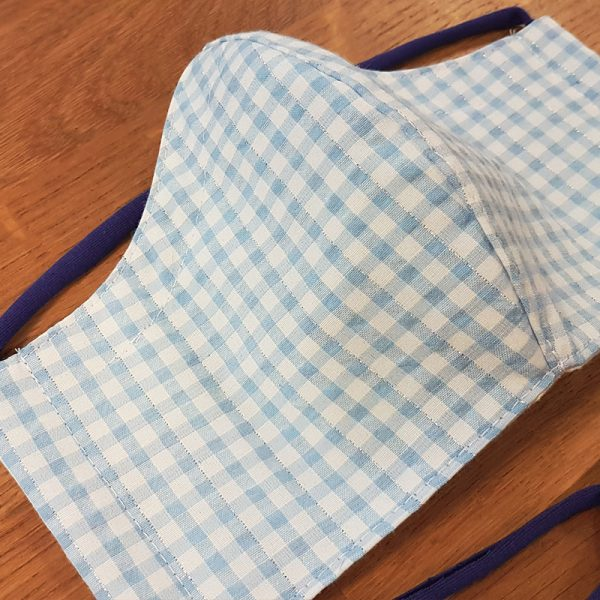 Fabric facemask with light blue and metallic silver gingham print
