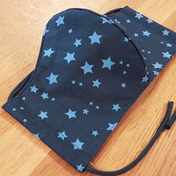 Fabric facemask with light blue stars on a navy blue background