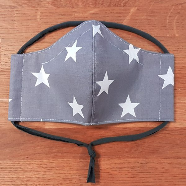 Fabric facemask with white stars on a grey background