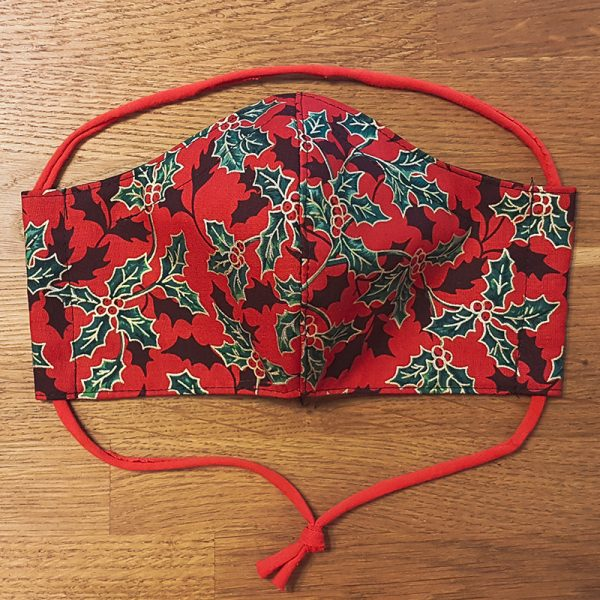 Fabric facemask with festive holly Christmas print with gold metallic details