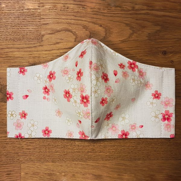 Fabric facemask with Sakura print on off white background