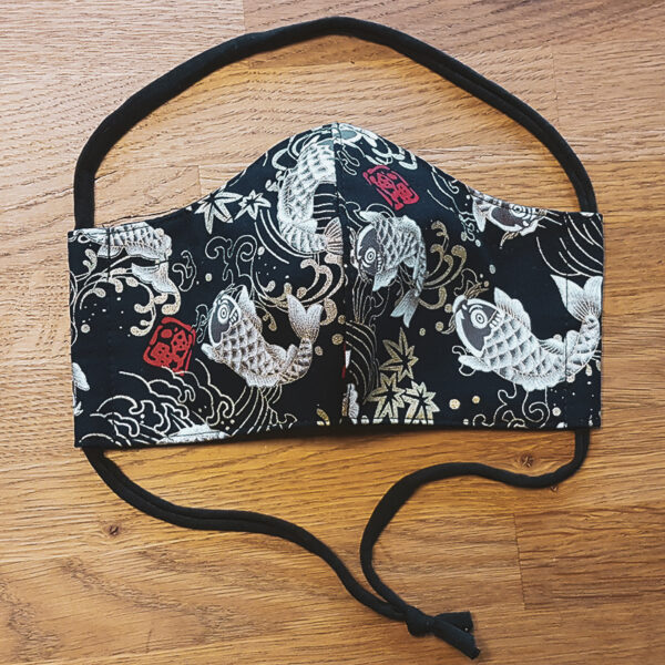 Fabric facemask with Koi karp print on black background