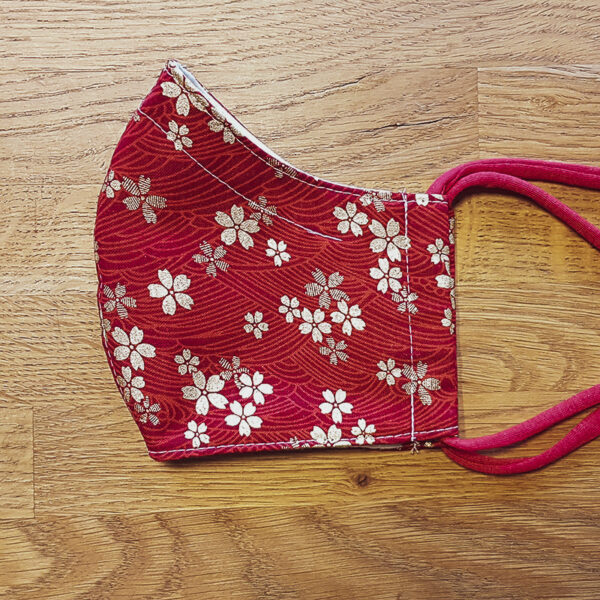 Fabric facemask with Golden Sakura print on red background