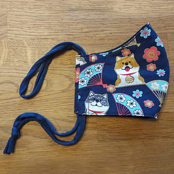 Fabric facemask with cute dogs and fans print on dark blue background